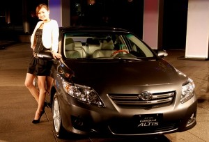 Beautiful Girl with Corolla Altis