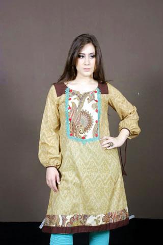 Desi Pakistani Girl in Maria B. Oranve Dress