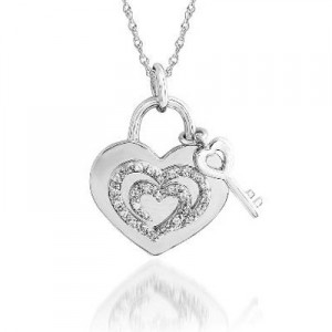 The Shared Heart® 1-10 CT. T.W. Diamond Heart Tag Pendant in Sterling Silver