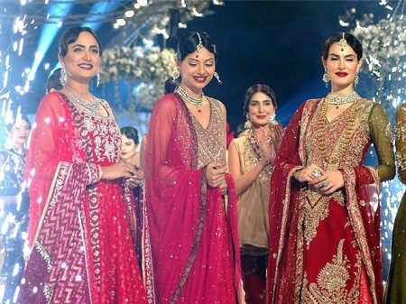 Models are exhibiting the bridal wear dresses prepared by designer, Zaheer Abbas.