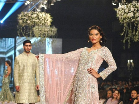 A model is exhibiting dresses prepared by fashion designer, Faraz Mannan