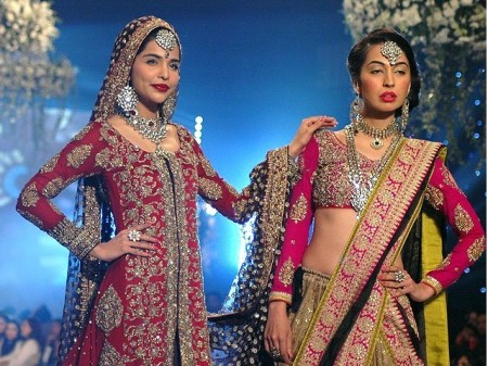 Models are displaying bridal wear dresses prepared by different fashion designers of Pakistan