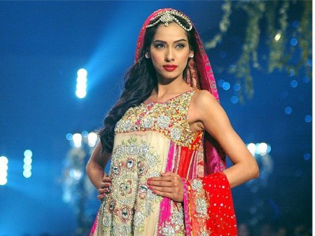 Models are displaying the bridal dresses prepared by the fashion designer, Yasmeen Zaman