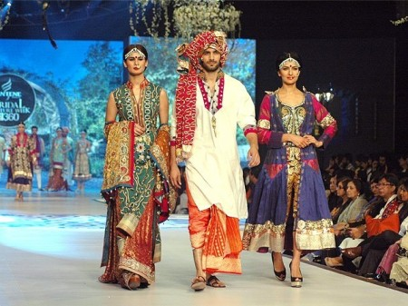 Models are exhibiting the bridal dresses prepared by the designers.