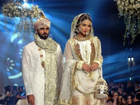 Models are exhibiting the bridal wear dresses prepared by different fashion designers of Pakistan