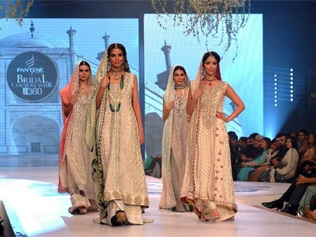Models are exhibiting the white colored beautiful and nice dresses prepared by the fashion designer Sana Abbas.
