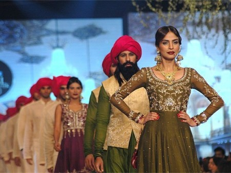 Models are showcasing the bridal wear dresses prepared by designer, Zaheer Abbas.