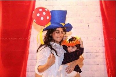Alishba Yousuf poses with her baby boy.