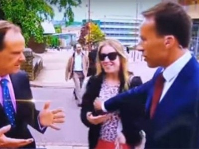 Slapped on Air for BBC Reporter to Touch Woman Breast